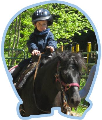 Enfant sur un cheval - Le Ranch des Petits Amis